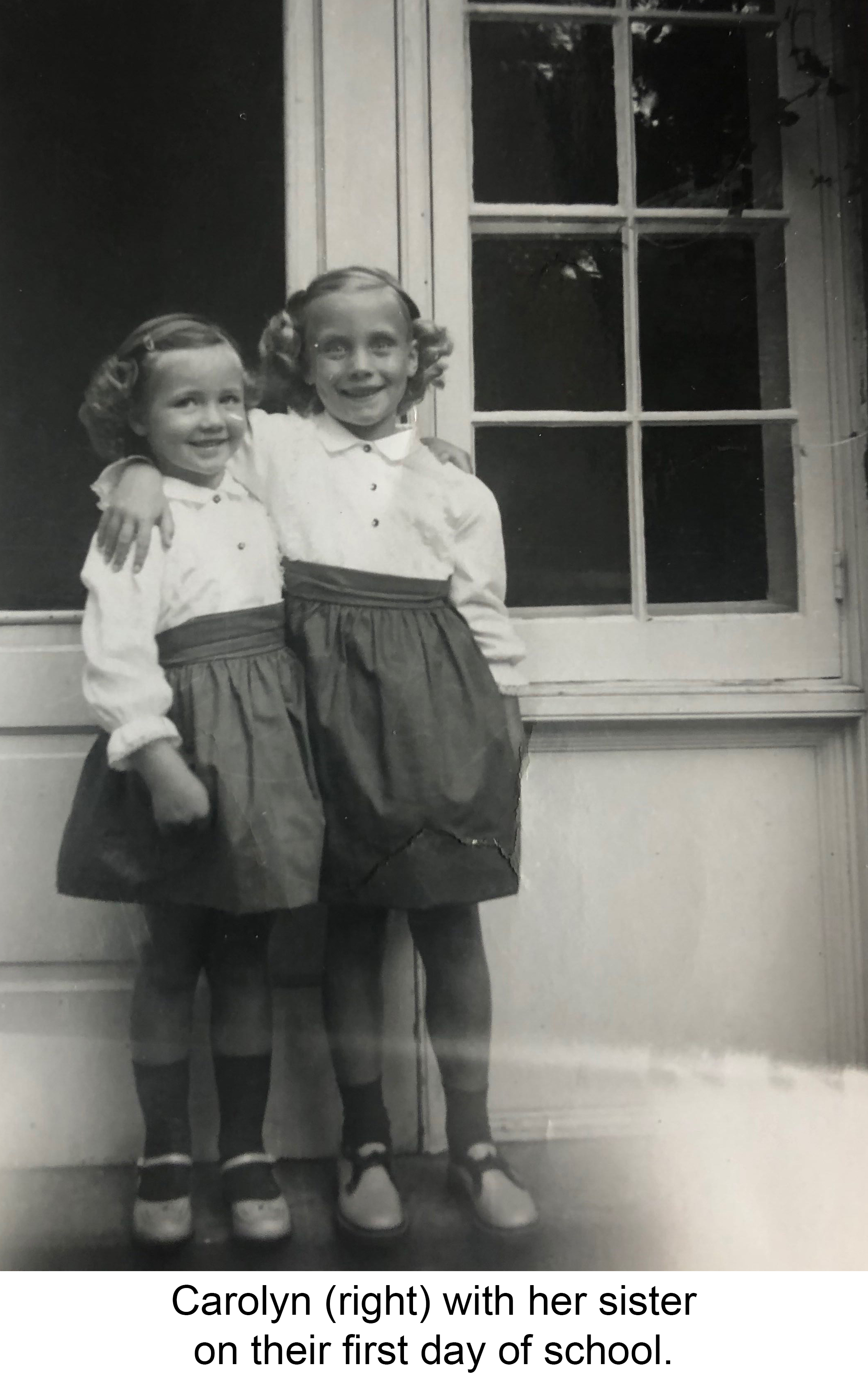 Carolyn with her sister on their first day of school